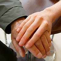 Photograph of people holding hands