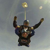 Photograph of previous SRSB Skydive participant doing the jump