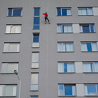 Photograph of a building with someone abseiling down