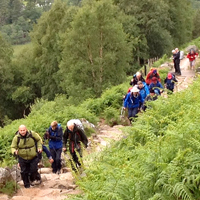Photo of the group walking up a hilly path