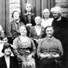 Old black and white photo of a group of residents from Overend Cottages