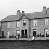 Black and white photo of the exterior of Overend Cottages