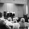 Black and white photograph of singers entertaining SRSB clients