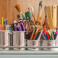 Photograph of paint brushes and craft tools