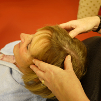 Photograph of someone massaging somones scalp