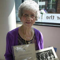 Photogrpah of Joyce at the centre with her letter and photograph of the CAPITOLS