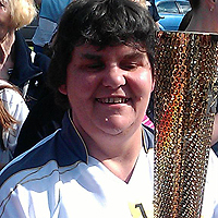 Photograph of Julie with the Olympic Torch