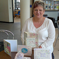 Photograph of Val at SRSB with some of her cards