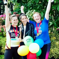 Photograph of Aisling with her friends at the end of the race