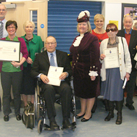 Photograph of SRSB volunteers with the High Sheriff