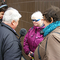 Photograph of SRSB clients being interviewed by Peter White