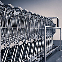 Photo of a row of shopping trolleys. From Michael Gaida on Pixabay