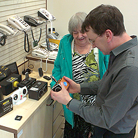 Photograph of SRSB client being shown products in the Equipment Centre