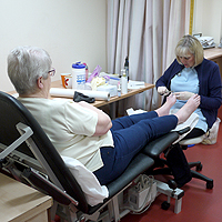 Photograph of SRSB client with Chiropodist