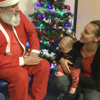Photo of mum and baby with Santa Claus
