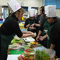 Photograph of youth club holding a cookery session