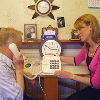 Photograph of one of SRSB's Community Advice Officers with a client discussing equipment