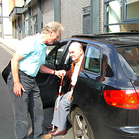 Photograph of an SRSB volunteer driver and client