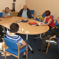 Photograph of clients discussing a book