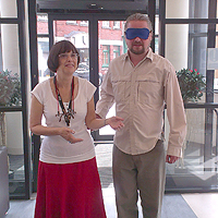 Photograph of volunteer receiving visual impairment awareness training