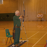 Photograph of visually impaired archer at group