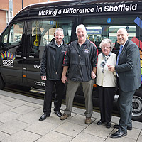Photograph of driver, client and minibus providers in front of minibus