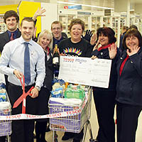 Photograph of Tesco staff presenting a cheque to SRSB