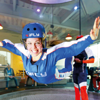 Photo of someone doing the indoor skydive