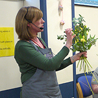 Photograph of Jill at a previous flower arranging event