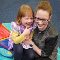 Photograph of one of our young clients with her mum