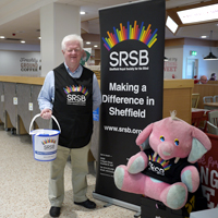 Photograph of SRSB volunteer at a store collection