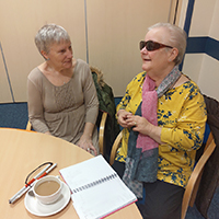 Photo of two people chatting in a support group