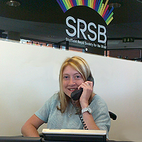 Photograph of SRSB volunteer on reception